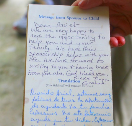 A family's treasured possession--a letter from their child's sponsor. It's tattered and covered with fingerprints from being handled so much.